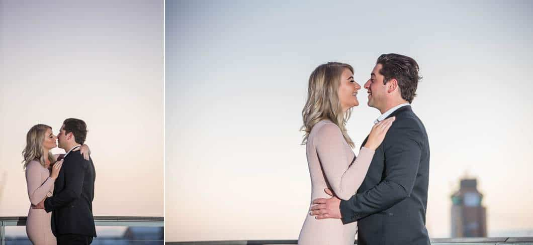 couple laughing kissing sunrise harbour engagement shoot