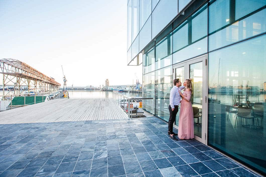 wide angle harbour glass building engagement shoot waterfront cape town
