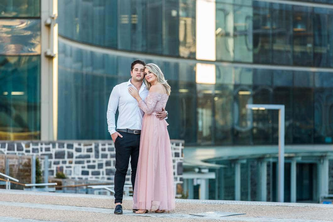 couple dressed for a cocktail party at their engagement shoot in cape town katie mayhew photography