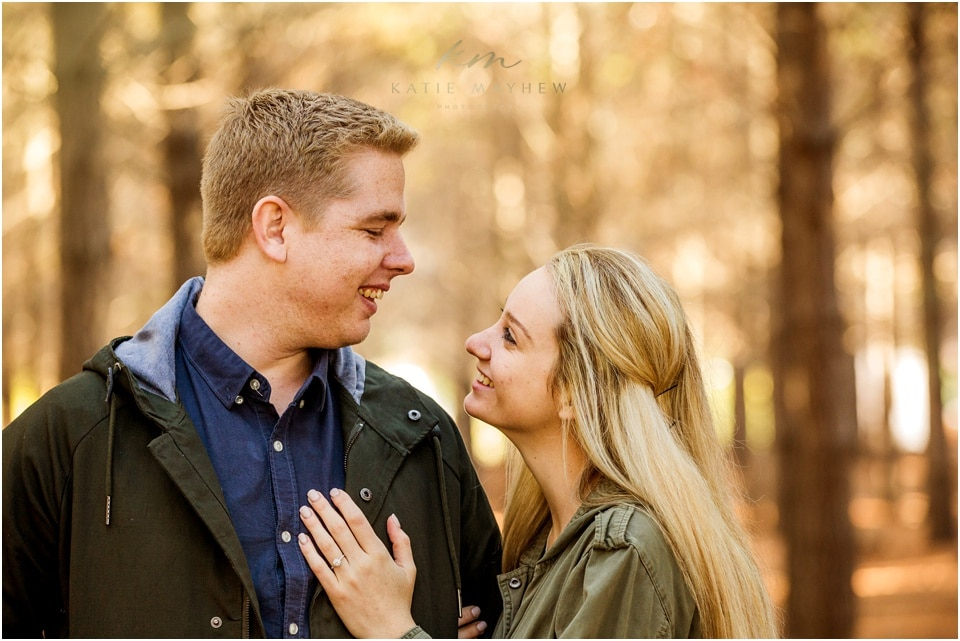 engaged couple in forest after proposal